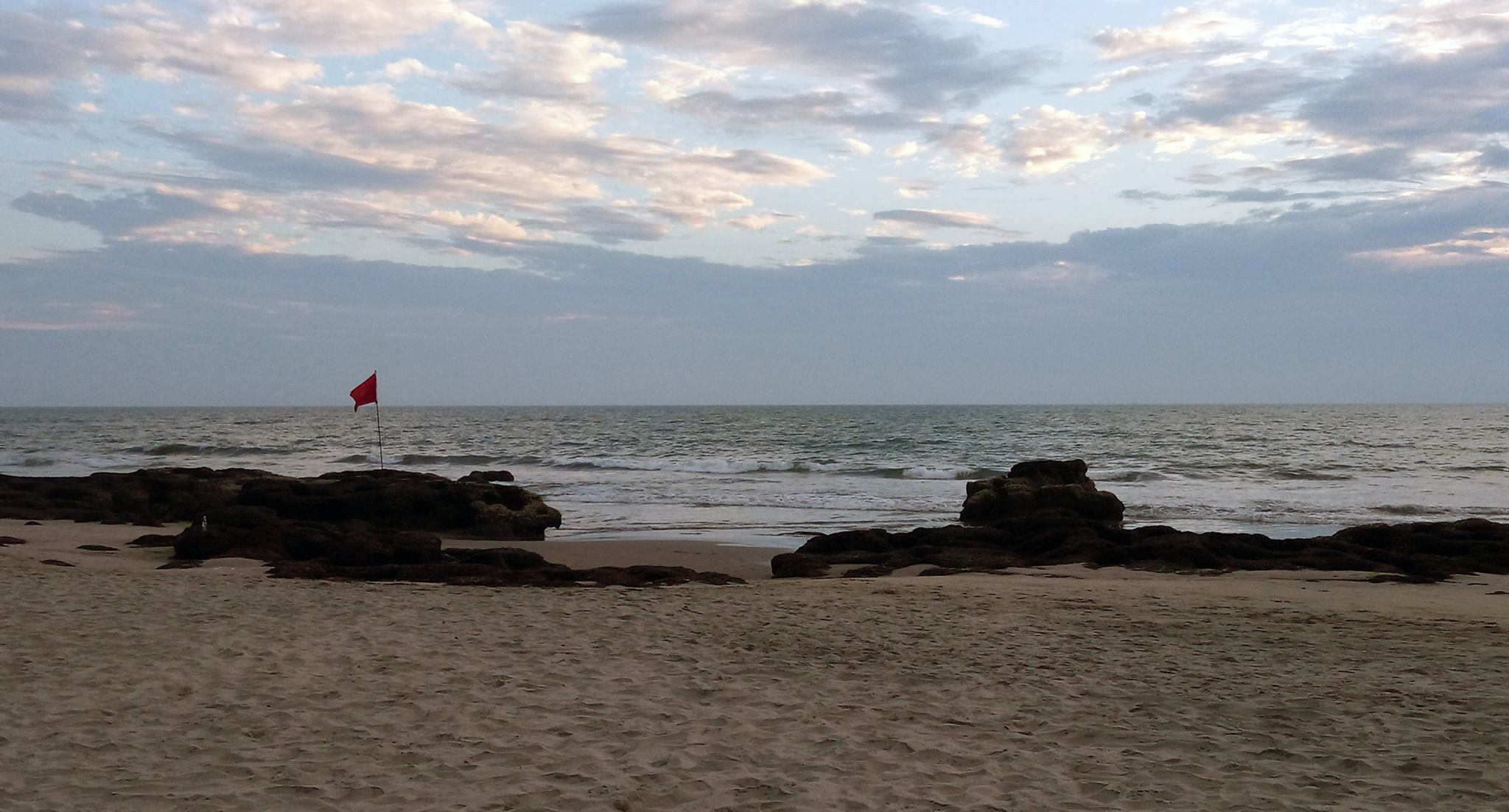 The Red Flag by the Blue Sea